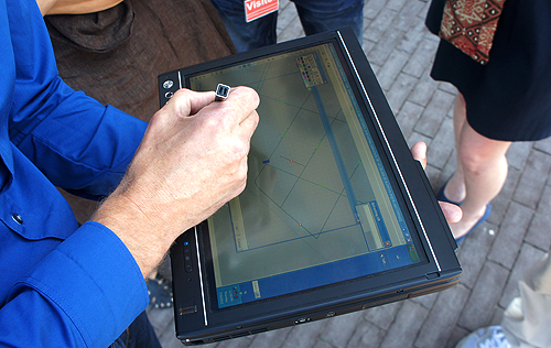 Using a tablet computer and TomTom's proprietary software, field staff can make changes to the base map which are then uploaded to TomTom's main map servers.