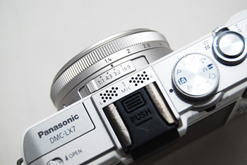 The LX7 gains an aperture ring, while retaining the less useful aspect ratio switch.