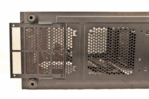 The washable dust filter for the air vents of the PSU; to its right are the air vents for the optional bottom 120mm cooling fan.