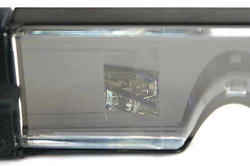 At an angle, you can catch a glimpse of the half-mirror/projection lens system within.