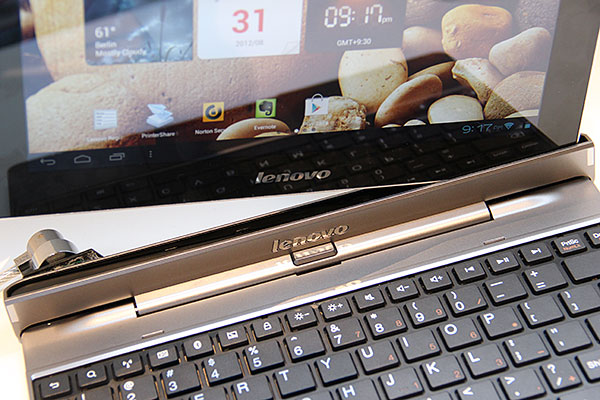 From what we've seen, the keyboard's docking mechanism holds the tablet pretty securely. To detach, just press the button below the Lenovo logo and pull the tablet.