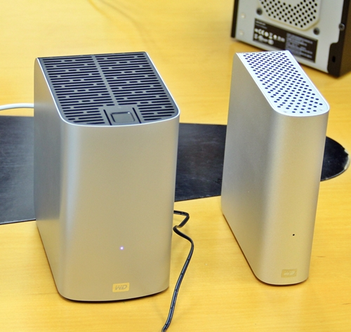 The My Book Studio external drive, on the right, is targeted at Mac OS system users, from its pre-formatted state to its brushed aluminum look. The fatter My Book Duo features an internal RAID 1 drive array with dual Thunderbolt ports for speedy file transfers and daisy-chaining with other Thunderbolt devices.