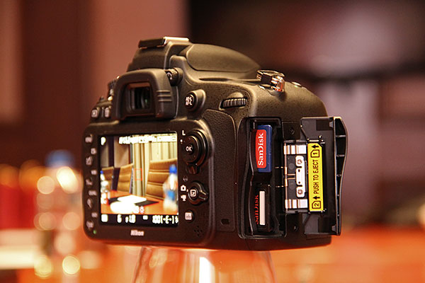 The D600 has dual SD card slots. You can do simultaneous recording to both cards, and even separate files according to format (JPEG/RAW) or type (still/video). Hmmm, doesn't the Sony A99 do these too?