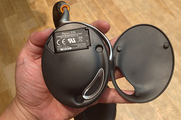 Removing a magnetic cover on the left earcup reveals the 800mAh lithium-ion battery.