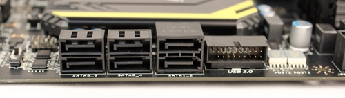 The pair of SATA 6Gbps connectors is distinctive enough from the four SATA 3Gbps ones, even though they are of the same color. A USB 3.0 front panel expansion header is placed next to the SATA 6Gbps connectors.