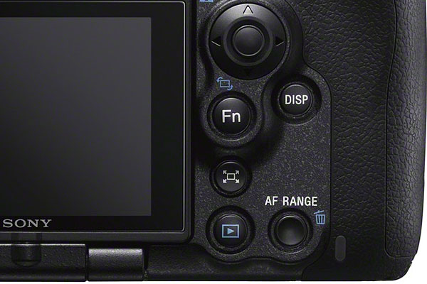 The AF Range Control button is located just beside the playback button.