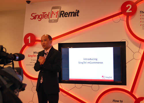 Mr Yuen Kuan Moon, SingTel's CEO Consumer Singapore, giving members of the press an overview of what the mRemit remittance service is all about.