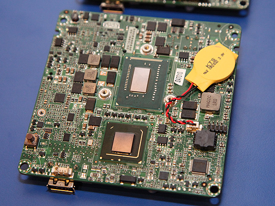 On the other side of the board, you'll find the Intel i3 Core processor and the QS77 chipset.