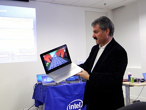 Mr. Garry Weil is shown holding an Intel Ultrabook of reference design.