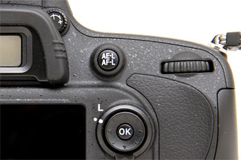 The D600 has one combined button for AE and AF lock.