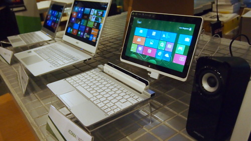No it's not an Ultrabook that has been beheaded. It's a hybrid tablet that comes bundled with its own keyboard dock,