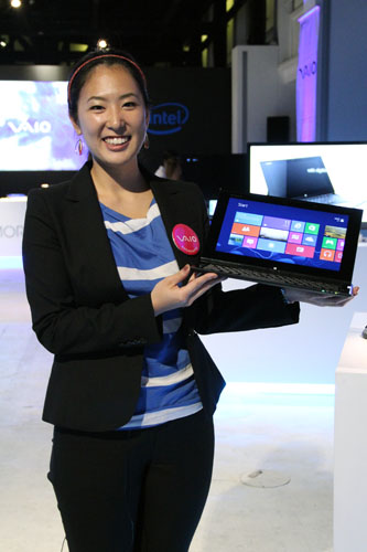 Sony UX Communications Product Manager, Ayumi Hashimoto, showing off the Vaio Duo 11.