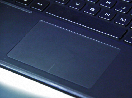 The glass trackpad is coated with a teflon like material. You can't fry an egg on it, but it does allow your finger to slide around very easily.
