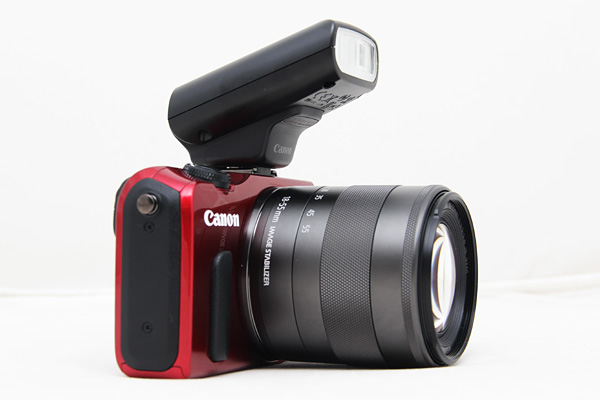The Speedlite flash attachment adds substantial bulk to the EOS M when attached.