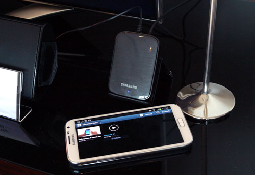 "Convert your ""dumb"" TV into a smart one with the Samsung AllShare Cast Hub (pictured above the Galaxy Note II)."