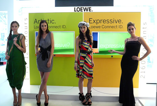 Loewe's Connect ID Smart TVs, fitted with Orange and Green fabric covers on the left and right respectively.