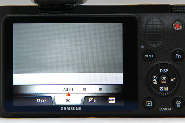 Pressing the i-Fn button brings up a overlay below the shooting screen, through which you can scroll through various settings.