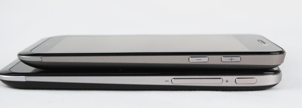 ASUS shifts the Power button to the right side of the PadFone 2 (bottom), and joins the volume controls which are integrated as one button.