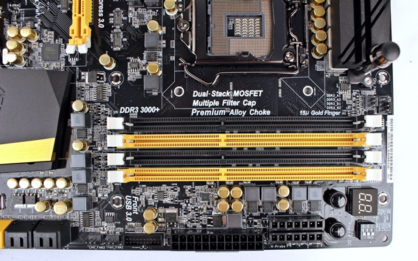 Located just beyond the DIMM slots, there are a number of high-end features targeted at power users; the PCIe DIP switch, Rapid OC buttons and V-Probe.