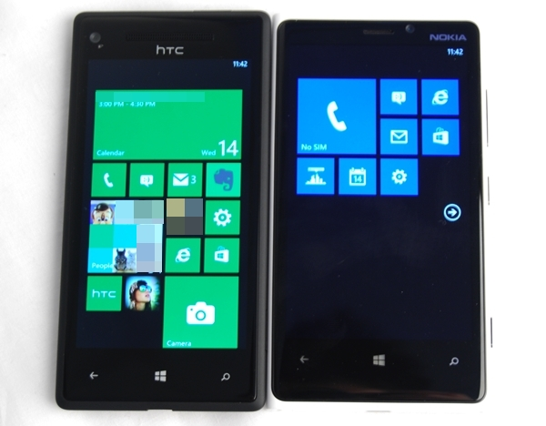 Due to its design and 4.5-inch display, the Nokia Lumia 920 (right) is wider than the WP8X by HTC (left).