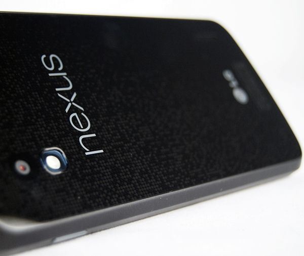 The back of the LG Nexus 4 stands out with its unique reflective pattern of tiny circles which reflect light at certain angles.