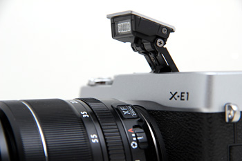 The X-E1 has a built-in flash, the X-Pro1 does not.
