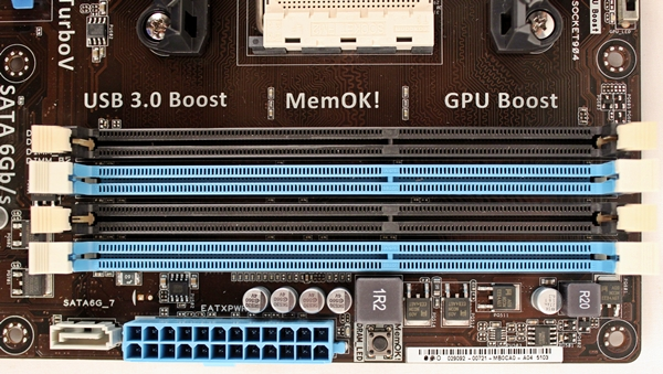 To the right of the FM2 socket, we see the color-denoted DIMM slots that are capable of supporting DDR3-2400+ memory modules, up to a maximum capacity of 64GB.