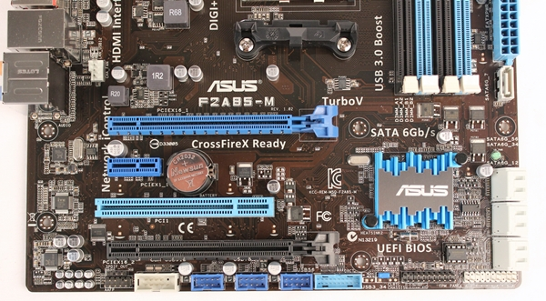 The bottom edge of the ASUS F2A85-M sports three USB 2.0 headers; they are the ones in bright blue color. This ASUS board has the most USB 2.0 headers, even beating out the normal ATX sized boards in our lineup. Also seen in this photo is the only heatsink across the entire board that's used for cooling the chipset.