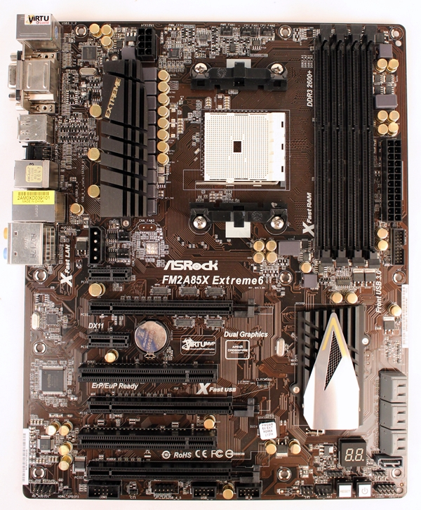 The ASRock FM2A85X Extreme6 is one of the two ATX boards in our lineup. It sports large gray heatsinks and gilded capacitors that are touted to have higher durability coupled with better performance in power regulation.