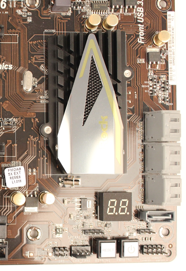 To the right of the chipset heatsink, there are the SATA 6Gbps connectors. There is also a lone SATA connector whose orientation is vertical, unlike the other six that have a 90 degree orientation.