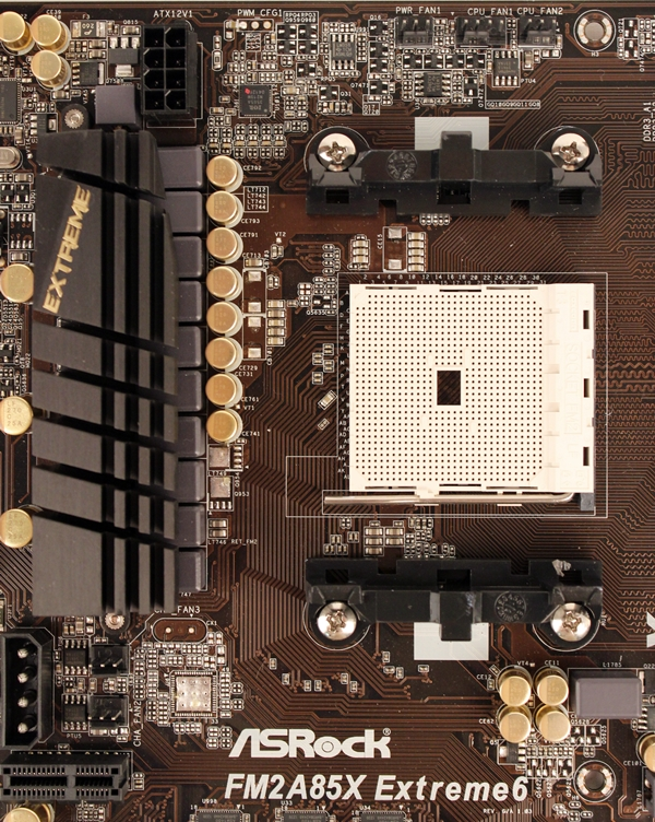 The lone heatsink provides passive cooling to the VRM components of the CPU; without the presence of a second VRM heatsink, the vicinity of the FM2 socket appears uncluttered.