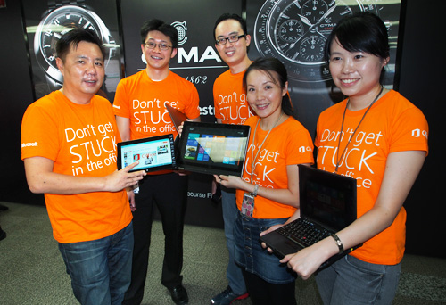 (Left) Danny Ong, Microsoft Malaysia's Chief Marketing & Operating Officer and Microsoft employees show off the brand new Office 365