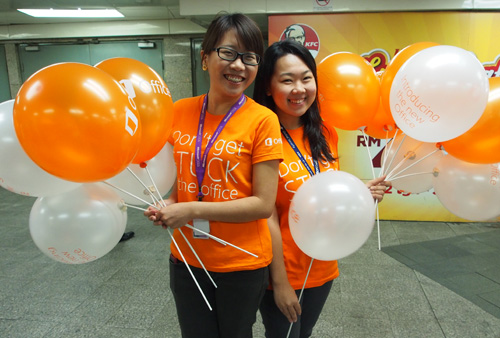 The atmosphere of the launch was festive, as employees handed out balloons to passers-by