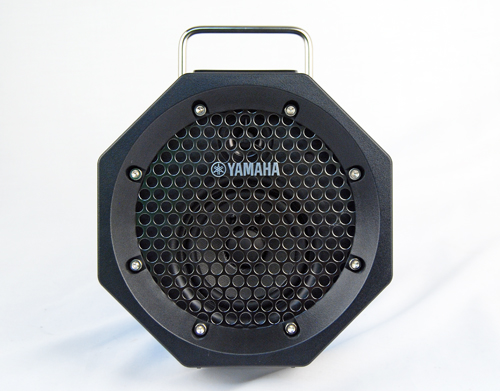 Head on, the octagonal shape of the portable speaker is evident.