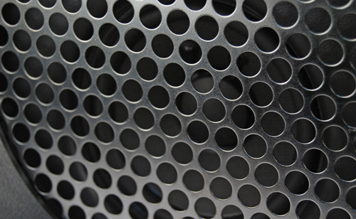 A finely constructed mesh covers the innards of the device.