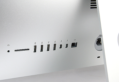 Round the back, from left to right, you'll find a headphones jack, a SDXC card reader, quadruple USB 3.0 ports, two Thunderbolt ports, Ethernet jack and further right is the power connector.