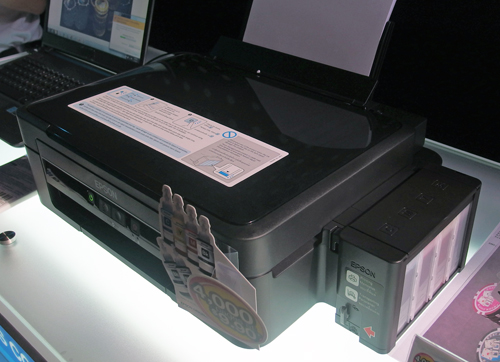 Pictured here is the L350. The ink tank is located on the printer's right. Unlike conventional inkjet printers which utilize ink cartridges, the L-series uses ink tanks.