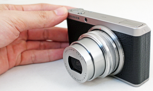 With an extending lens barrel and a rotating zoom ring, the XF1 requires both hands on the camera to shoot.