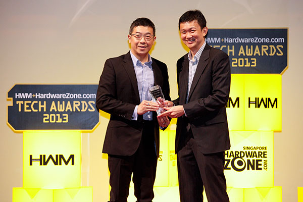 ASUS took home four awards, including Editor's Choice for Best 802.11ac Wireless Router (RT-AC66U) and Readers' Choice for Best Motherboard Brand. Here's Mr. Darwin Wu, Regional Director for OPBG, ASUS, accepting the awards.
