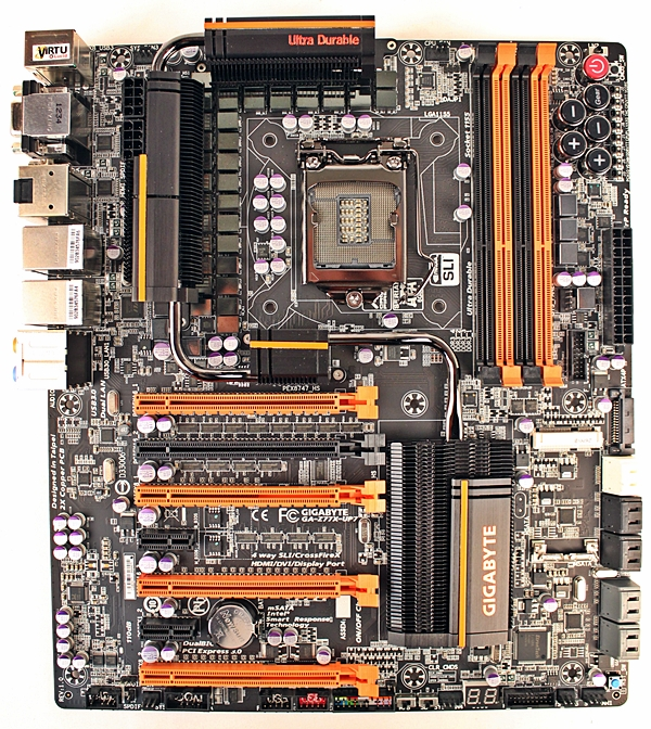 The Gigabyte GA-Z77X-UP7 motherboard is an aesthetically glaring board with its bright orange streaks set against its black PCB. The sheer amount of its feature set at first glance is enough to set our minds reeling. From its onboard OC buttons to its VRM cooling system that has been linked by a snaking silver heatpipe, the board is practically bursting at its seams with various onboard components!