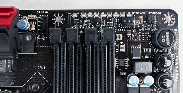 It is rather cluttered at this edge of the board with two fan connectors located very close to the DrMOS and CPU Power Phase LEDs. At the adjacent edge, we see the three on-board buttons that are called Easy Button 3.