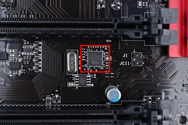 The VIA VT6315N host controller chip that powers the IEEE 1394 expansion connector is located between the second and last PCIe x16 slots.