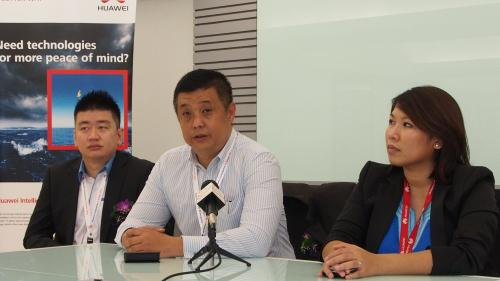 Mr. Tan and Mr. Hwong seen here in the Innovation Center's conference room, fielding questions from the press