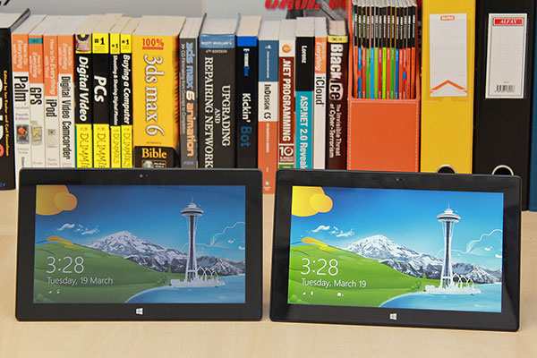 The same 10.6-inch screen size, the same front-facing camera placement, the same 18mm black bezel, the same capacitive Windows logo button - can you tell which one is Surface RT and which one is Surface Pro? (Hint: the Surface Pro is 1mm taller.)