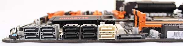 To the left, the gray SATA 6Gbps connectors are courtesy of the Marvell controllers; while the black SATA 3Gbps and the pair of white 6Gbps connectors are provided by the Intel Z77 chipset.