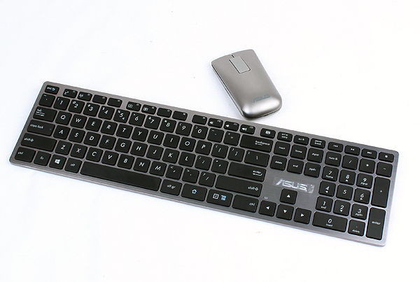 The provided wireless keyboard and mouse combo is not the best in the world as the keyboard felt a tad flimsy. The mouse features haptic technology, which takes some getting use to.