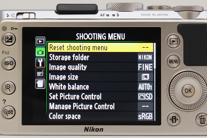 The Exposure Compensation button is on the top left, so you need two hands to adjust exposure.