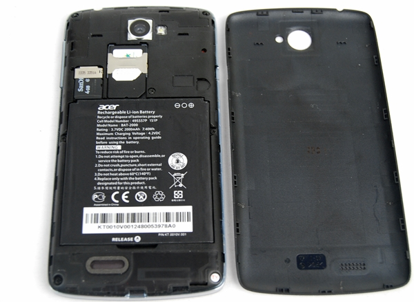 You have to first remove the battery cover, and then the battery to access the microSD and micro-SIM card slots.