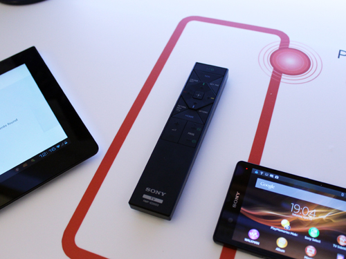 The new remote for the Bravia TVs is extremely thin and also allows for pairing with Xperia tablets and smartphones via NFC. This feature is called One Touch mirroring.