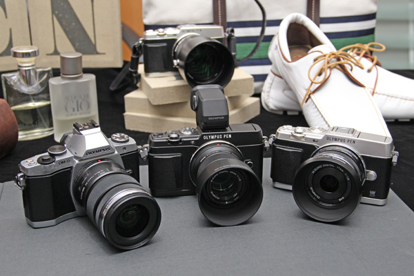 The E-P5 isn't much smaller than the Olympus E-M5, in fact, it's taller with the optional VF-4 electronic viewfinder.